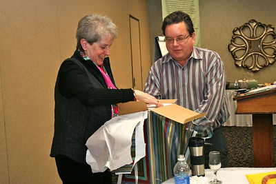 Sr. Barbara receives a gift from the steering committee