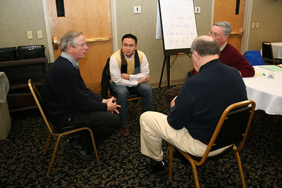 Fr. Thi Pham, Fr. Tom Cassidy and Br. Ray Kozuch listen to Fr. John van den Hengel