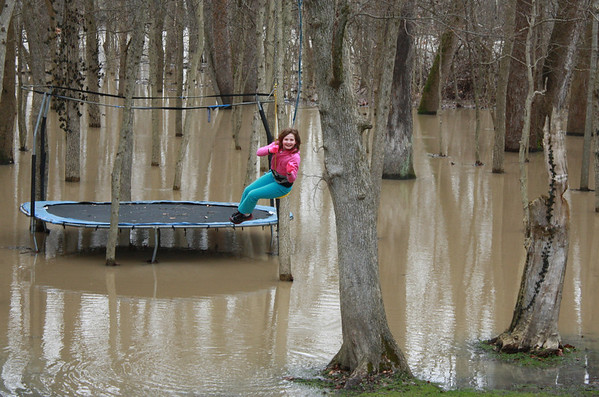 Leah Landers doesn't let the flood along White River in Anderson keep her from going outside and having a little fun on her swing in the back yard, 2:30pm January 14, 2013.<br /> <br /> Photographer's Name: Rachel Landers<br /> Photographer's City and State: Anderson, IN