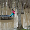 Leah Landers swings out over the flood waters in her back yard along the White River on January 14.<br /> <br /> Photographer's Name: Rachel Landers<br /> Photographer's City and State: Anderson, IN