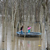 A flood along White River in Anderson won't keep these two girls from playing on their trampoline!<br /> <br /> Photographer's Name: Rachel Landers<br /> Photographer's City and State: Anderson, IN