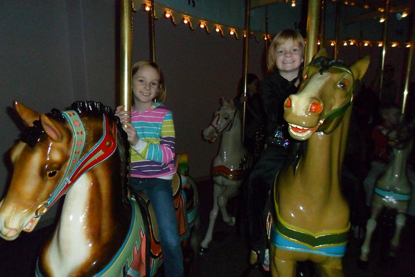 Natalie Long, 7, and Kendall Long, 4, on the carousel at the Indianapolis Children's Museum.<br /> <br /> Photographer's Name: Carrie Long<br /> Photographer's City and State: Alexandria, Ind.