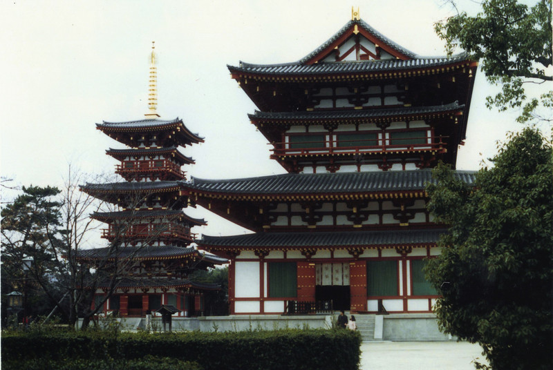 """This is Yakushi-ji, in Nara. Like many of the incredibly ancient national treasures there, it's sort of in the middle of some fields. Riding along a normal street, you don't expect to see these pagodas rising above some phone lines and trees; and it's even more incongruous when you know the temple was built (in this case) in the late 600s.<br /> <br /> The buildings in this photo (main hall and west pagoda) are new, having been redone in the 1200s and 1700s. These Tale of Genji people (link below) have done a nice job summarizing various temples, with photos more attractive than mine.<br /> <br /> <br /> <a href=""""http://www.taleofgenji.org/yakushiji.html"""">http://www.taleofgenji.org/yakushiji.html</a>"""