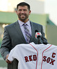 FORT MYERS, FL, March 1, 2012: Former Boston Red Sox catcher Jason Varitek smiles as he answers a question from the media after officially announcing his retirement from baseball after 15 Major League seasons with the Red Sox. (Brita Meng Outzen/Boston Red Sox)