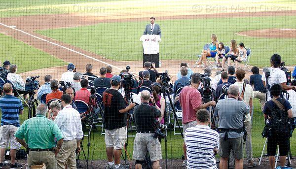 FORT MYERS, FL, March 1, 2012: Media, teammates and Boston Red Sox executives and partners gather on the field at JetBlue Park at Fenway South to listen to Red Sox catcher Jason Varitek announce his retirement from baseball after 15 Major League seasons with the Red Sox. (Brita Meng Outzen/Boston Red Sox)