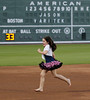 FORT MYERS, FL, March 1, 2012: Caroline Varitek, youngest daughter of retired Boston Red Sox catcher Jason Varitek, runs the bases barefoot while the Green Monster scoreboard at JetBlue Park displays her father's name and number after his retirement announcement. (Brita Meng Outzen/Boston Red Sox)