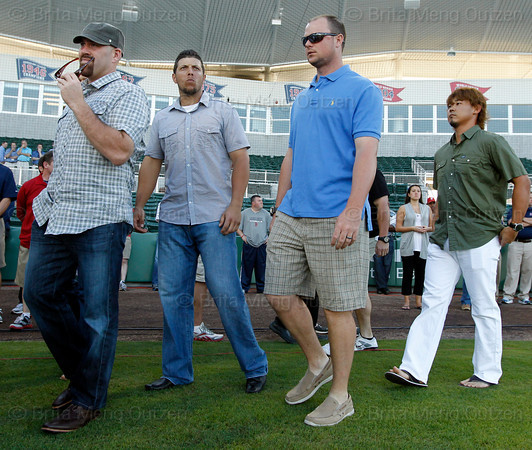 FORT MYERS, FL, March 1, 2012: From left, Boston Red Sox players  Kevin Youkilis, Luis Exposito, Jon Lester and Daisuke Matsuzaka walk onto the JetBlue Park field to attend the retirement announcement of former teammate Jason Varitek after 15 Major League seasons with the Red Sox. (Brita Meng Outzen/Boston Red Sox)
