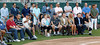 FORT MYERS, FL, March 1, 2012: From top left standing, Boston Red Sox players Daniel Bard, Tim Wakefield, Ryan Lavarnway, Rich Hill, Clay Buchholz, David Ortiz, Jacoby Ellsbury, Josh Beckett, John Lackey, Jarrod Saltalamacchia, Jon Lester and Daisuke Matsuzaka; parents Joe and Donna Varitek, seated front center; personal trainer Leslie Eddins, seated front fourth from right; and agent Scott Boras, seated front second from right listen as Red Sox catcher Jason Varitek announces his retirement from baseball. (Brita Meng Outzen/Boston Red Sox)