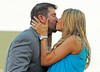 FORT MYERS, FL, March 1, 2012: Former Boston Red Sox catcher Jason Varitek, left, gets a kiss from wife Catherine after announcing his retirement from baseball after 15 Major League seasons with the Red Sox. (Brita Meng Outzen/Boston Red Sox)