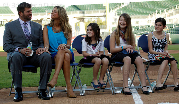 FORT MYERS, FL, March 1, 2012: From left, Boston Red Sox catcher Jason Varitek, wife Catherine, and daughters Caroline, Alexandra and Kendall wait on the JetBlue Park field for his retirement announcement  to begin. (Brita Meng Outzen/Boston Red Sox)