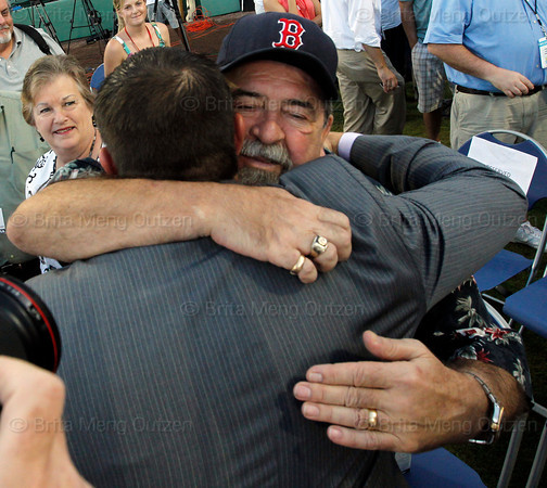 FORT MYERS, FL, March 1, 2012: Former Boston Red Sox catcher Jason Varitek, center, gets a hug from his father Joe, right, after announcing his retirement from baseball. Varitek's mother Donna is at left. (Brita Meng Outzen/Boston Red Sox)