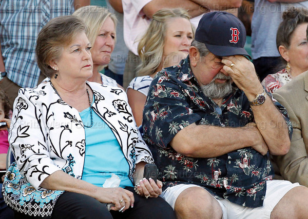 FORT MYERS, FL, March 1, 2012: Donna Varitek, left, mother of Boston Red Sox catcher Jason Varitek, clutches tissues while father Joe wipes his eyes as their son announces his retirement from baseball after 15 Major League seasons with the Red Sox. (Brita Meng Outzen/Boston Red Sox)
