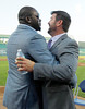 FORT MYERS, FL, March 1, 2012: Former Boston Red Sox catcher Jason Varitek, right, gets a big hug from former teammate Red Sox designated hitter David Ortiz after announcing his retirement from baseball. (Brita Meng Outzen/Boston Red Sox)