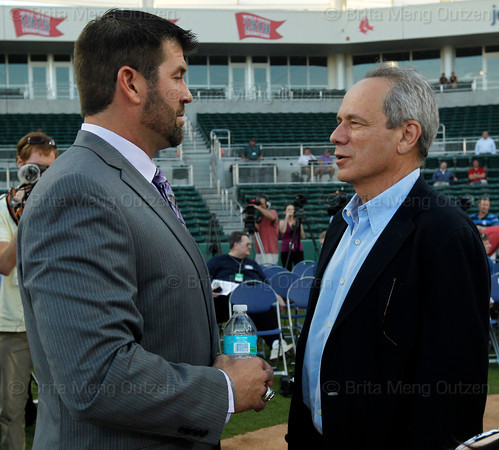 FORT MYERS, FL, March 1, 2012: Former Boston Red Sox catcher Jason Varitek, left, talks with Red Sox president and CEO Larry Lucchino after retiring from baseball after 15 Major League seasons with the Red Sox. (Brita Meng Outzen/Boston Red Sox)