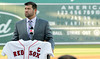 FORT MYERS, FL, March 1, 2012: With his name on the Green Monster scoreboard at JetBlue Park, Boston Red Sox catcher Jason Varitek announces his retirement from baseball after 15 Major League seasons with the Red Sox. (Brita Meng Outzen/Boston Red Sox)