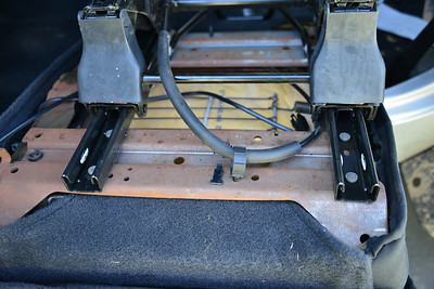 The cable is shown in the bad spot. Not the rubber cover has been stripped by trying to move the seat.