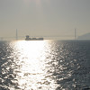 A barge with the Golden Gate bridge in the distance