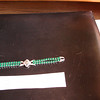 Green brilliant bracelet came from Birks.  I actually asked for it from my dad for an Xmas gift.  I had seen it and loved it.  My very favourite brilliant piece of jewellery.  Cost $5.00 - certainly not more than $10.<br /> <br /> My mom wore this bracelet once at Christmas.  She and Francine danced to ABBA and the bracelet is visible in the photo.  I could not part with this as it reminded me of the many happy Christmases we had here at Oakdene Crescent.