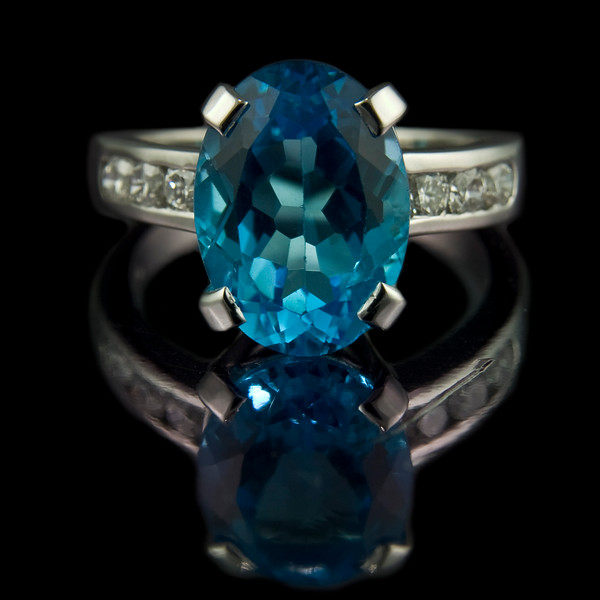 Swiss blue topaz diamond ring<br /> <br /> Blue topaz bespoke ring with channel set bespoke diamonds in 18ct white gold. Made and photographed for Rumour