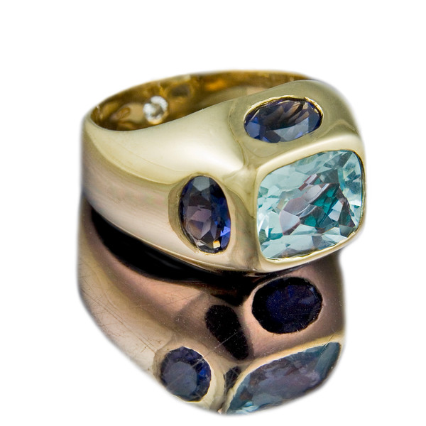 'Compass' cocktail ring with Blue Topaz and Iolite in 18ct yellow gold.<br /> <br /> So named as the it has a stone at each point of the compass. You can also choose to have this ring with other coloured stones.