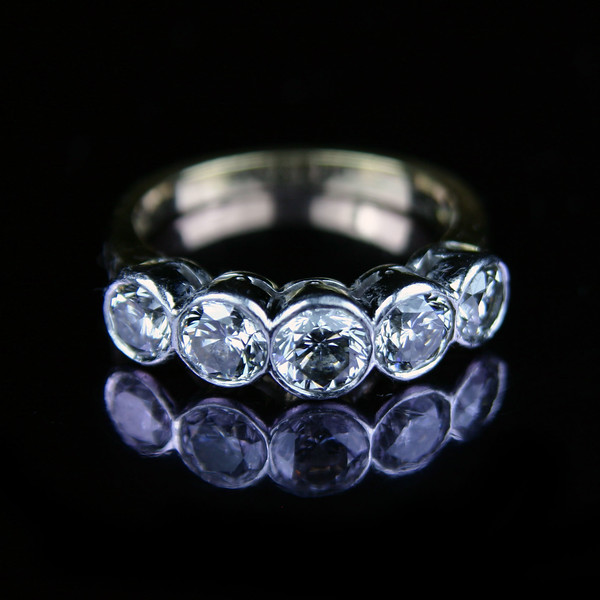 Five stone brilliant cut engagement ring