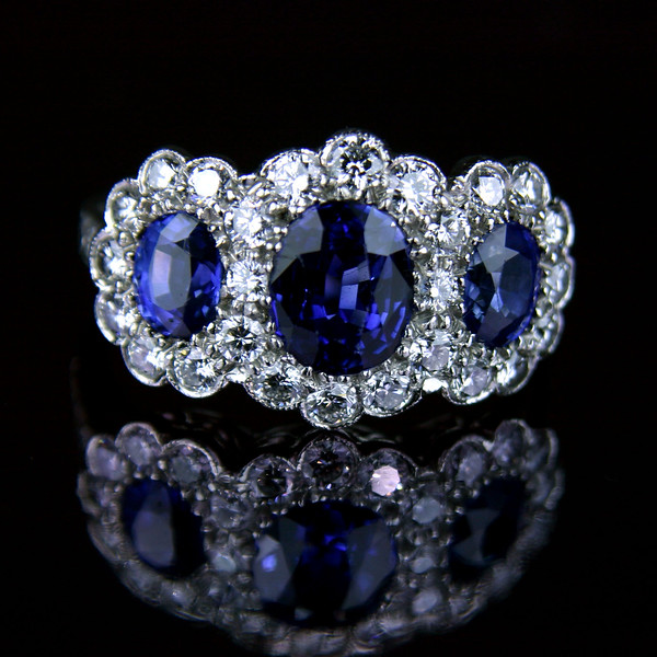 Triple ceylon sapphire diamond cluster engagement