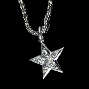 Diamond Star  White gold star pendant with pave set diamonds on 18ct gold chain.  Photographed for Rumour.