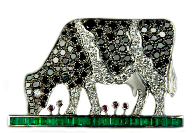 Black and white diamond cow brooch<br /> <br /> I designed this for a bovine lover!  Black and white diamond cow grazing on a field of emeralds! (Ruby poppies)  I photographed it for Rumour's bespoke jewellery portfolio and website. <br /> <br /> Please do not comment on these images in order to place hyperlinks to your own businesses or commercial blogs without permission (comments will be deleted and you will be blocked). Thanks.