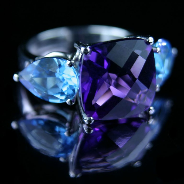 Rumour's Amethyst cocktail ring<br /> <br /> A shot designed to entice you after dark! Amethyst cushion and pear shaped blue topaz ring handmade in 18ct white gold. I photographed this for the front of our 2006 jewellery brochure and website. Made in our Singapore workshop.