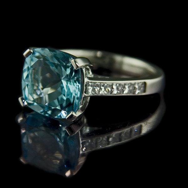 Cushion cut aquamarine engagement ring<br /> <br /> One of my best shots of an aquamarine (I reckon!)...<br /> <br /> Cushion cut aquamarine engagement ring with princess cut diamonds stones in a platinum setting.  This was made in our Singapore workshop and then photographed by me in London before delivery to the client. Images are used in our portfolio to inspire new clients and on our website.