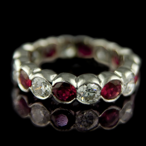 "Diamond and ruby eternity ring<br /> <br /> One of my favourite eternity ring designs.  Brilliant cut diamond and ruby eternity ring in a platinum rub-over setting. The 2.20ct diamonds and 3.04ct of perfect ""traffic light red"" rubies are in fact the same dimensions, the rubies just weigh more! Made for one of our clients and photographed for our bespoke portfolio."
