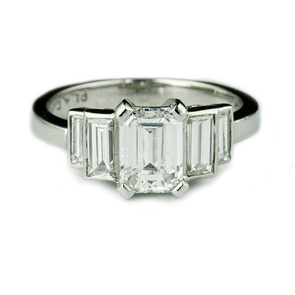 Emerald and baguette cut diamond engagement ring <br /> <br /> Emerald cut diamond engagement ring with double step-down baguette diamonds. Set in platinum.  I photographed this ring after it was made for a Rumour client and photographed for the bespoke jewellery portfolio and website.
