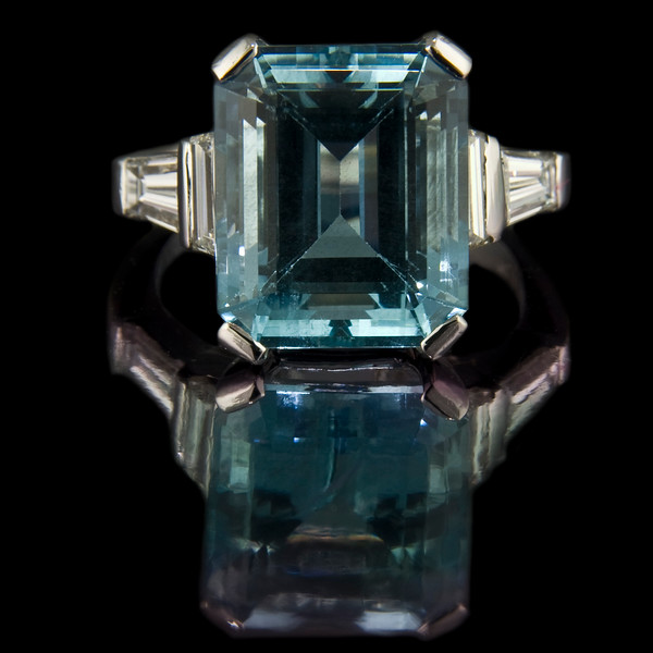 Emerald cut aquamarine engagement ring<br /> <br /> 8.2ct emerald cut aquamarine with trapezoid cut and tapered diamond step-down shoulders set in platinum..<br /> <br /> The ultimate aquamarine ring.