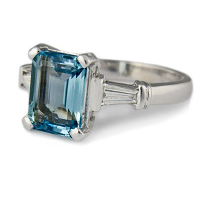 Emerald cut aquamarine  4ct emerald cut aquamarine with tapered diamonds set in 18ct white gold.  A timeless design for art deco style.  Photographed for the Rumour Jewellery portfolio.  A ring we made a while ago that came in for a service and stone re-condition.