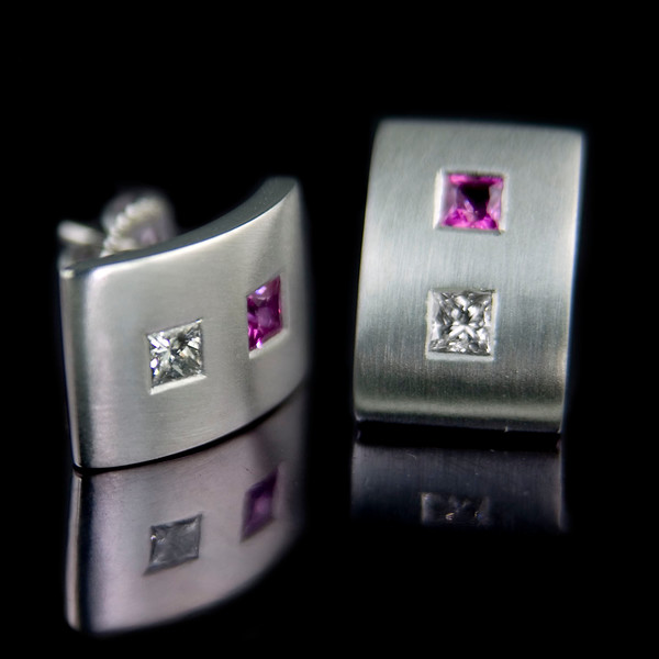 Pink sapphire and diamond earrings<br /> <br /> Bespoke earrings made with princess cut stones and matt finished white gold. I recently photographed this for our website and jewellery design portfolio.