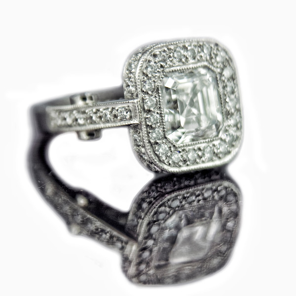 Asscher cut diamond engagement ring 2008A new version of an old favourite.<br /> <br /> The bespoke Asscher cut diamond engagement ring remains one of our most popular designs... and most expensive, so we don't make them very often!<br /> <br /> 2.01ct Asscher cut G colour, VS2 clarity, excellent cut, excellent polish.... you get the general idea!<br /> <br /> Photographed for our portfolio.
