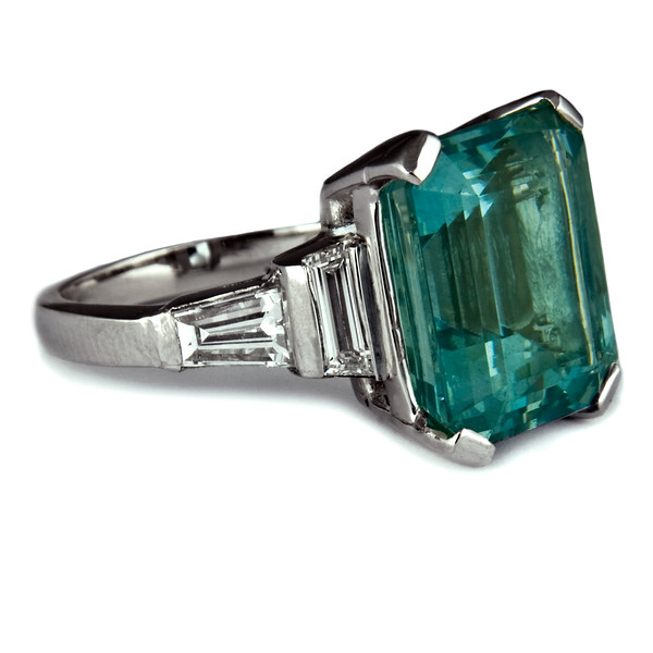 Emerald cut aquamarine engagement ring<br /> <br /> 8.2ct emerald cut aquamarine with trapezoid cut and tapered diamond step-down shoulders set in platinum..<br /> <br /> The ultimate aquamarine ring.