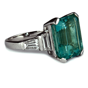 Emerald cut aquamarine engagement ring  8.2ct emerald cut aquamarine with trapezoid cut and tapered diamond step-down shoulders set in platinum..  The ultimate aquamarine ring.