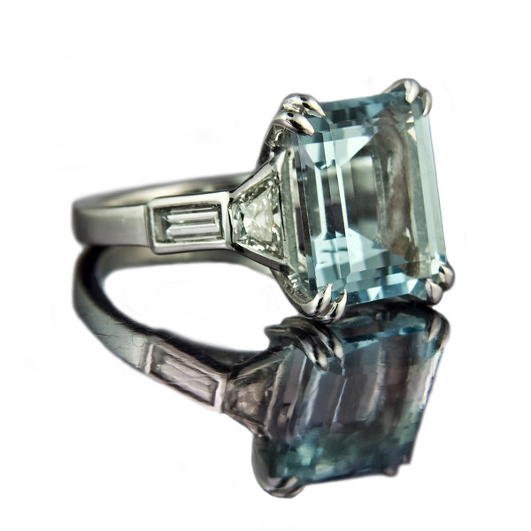 11 x 9mm Emerald Cut Aquamarine with step-down trapezoid diamonds and baguette diamonds set in platinum.<br /> <br /> One of the very best aquamarine engagement ring designs we have done in my humble opinion! Photographed for Rumour Jewellery Bespoke portfolio