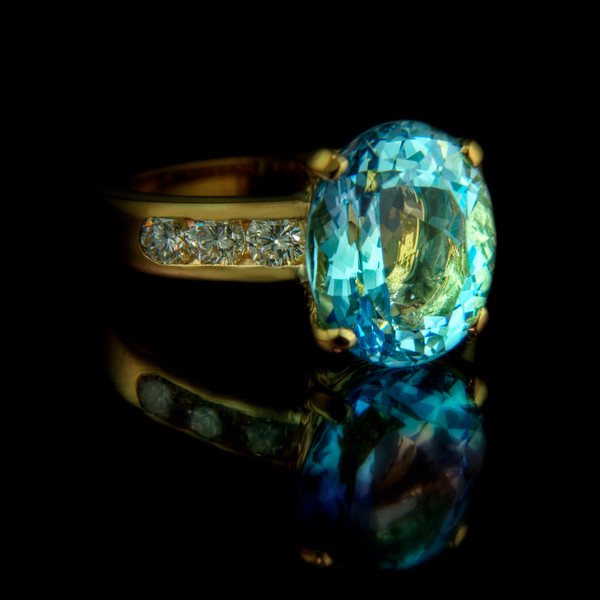 Aquamarine and diamond ring in 18ct yellow gold<br /> <br /> 4.65ct oval aquamarine with six 0.10ct brilliant cut diamonds set in 18ct yellow gold. Photographed for the website and portfolio.