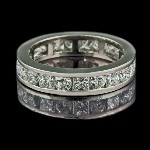 Brilliant & princess cut diamond eternity ring<br /> <br /> Brand new eternity ring... all the way round princesses and brilliants...set in platinum:  perfection really.  Photographed for Rumour's bespoke jewellery portfolio and website. .