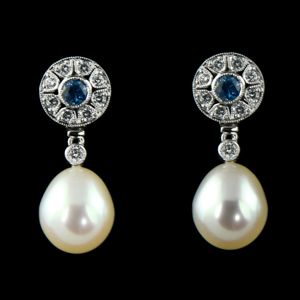 Sapphire, diamond and pearl earrings<br /> <br /> Brilliant sapphire and diamond drumtop earrings with detachable pearl drops.<br /> Set in white 18ct gold.<br /> <br /> One of our old classics...  came back in for a clean.. always nice to see the old work once in a while. Photographed for the Rumour portfolio.