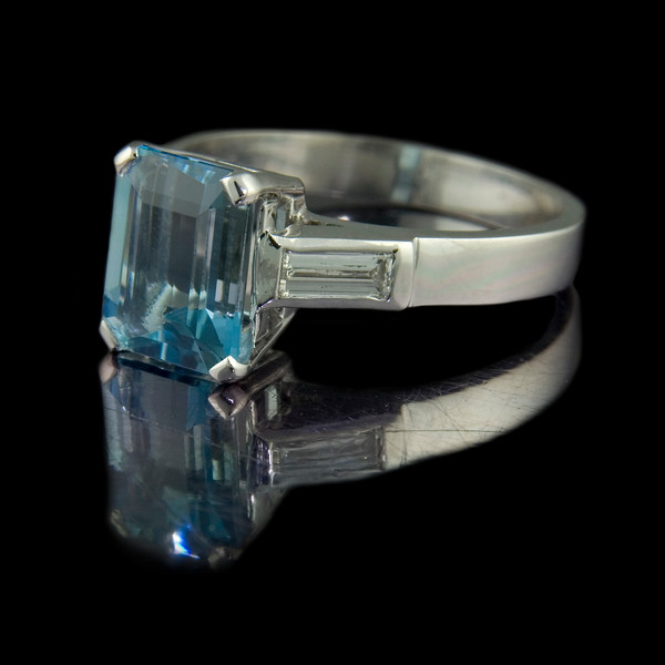 Emerald cut aquamarine engagement ring<br /> <br /> 1.97ct near perfect emerald cut aquamarine with horizontally set baguette diamonds in 18ct white gold engagement ring for a  bespoke jewellery client. I photographed this for our bespoke portfolio and website.