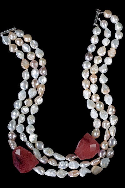 Multi-baroque pearl necklace with two large cherry quartz<br /> <br /> Another tricky one to photgraph, can't be done with my usual macro lens.  Three row multi-baroque pearl necklace with two large cherry quartz on  the 2007 Cocktail Collection brochure.