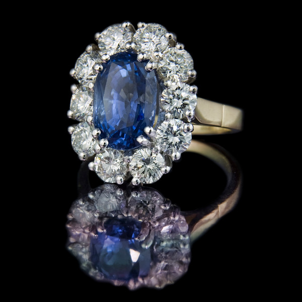 """""""Huntress""""<br /> <br /> 3.50ct oval Ceylon sapphire with 2.50cts of brilliant cut dimaonds. Set in 18ct yellow gold and platinum.<br /> <br /> An impressive engagement ring made for a client who managed to buy the central stone on holiday in Sri Lanka."""