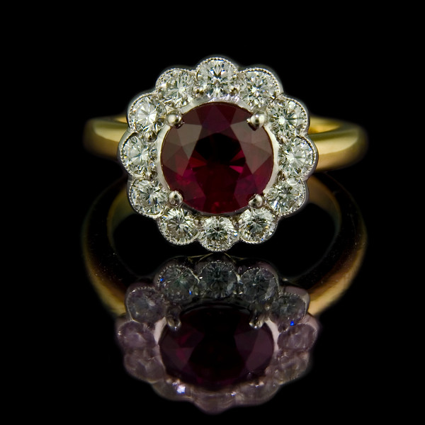 Ruby and diamond engagement ring<br /> <br /> 2.25ct perfect round ruby surrounded by 0.93cts of brilliant cut diamonds set in platinum with 18ct yellow gold shank.  Finished today for a Rumour Jewellery bespoke client.