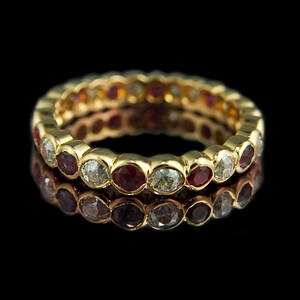 Ruby & diamond eternity ring  Brilliant cut ruby and peridot eternity ring set in 18ct yellow gold..  This full eternity ring combines a colourful style with minimalist design. Based on our diamond and ruby design.  Photographed for Rumour Jewellery website and portfolio