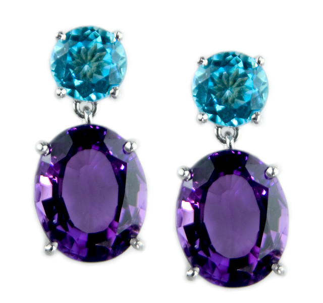 """Bon Bon Cocktail Earrings""<br /> <br /> Blue Topaz (6mm) and oval Amethyst (11 x 9mm) drop earrings.<br /> <br /> Beautiful colour combinations in these earrings which can be made with other coloured stone combinations."