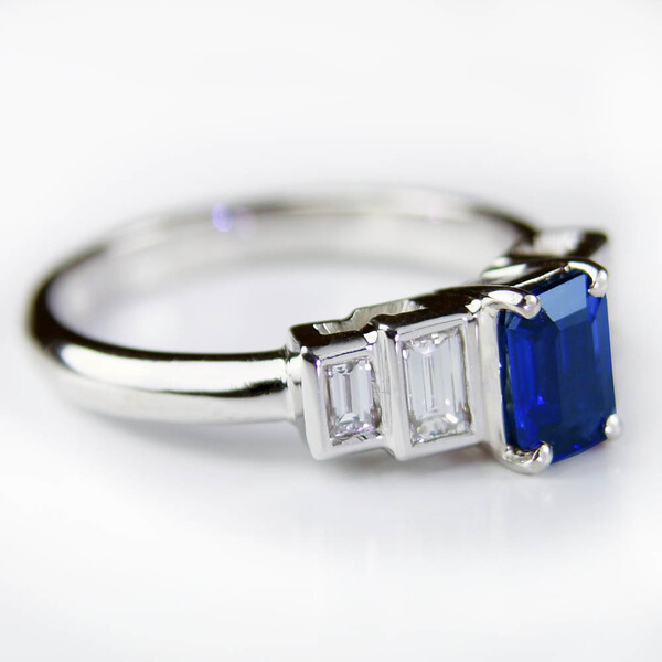 Emerald cut sapphire ring with baguette diamonds