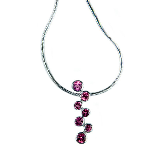 Pink tourmaline pendant<br /> <br /> Six pink tourmalines pendant  I photographed for Rumour's bespoke jewellery portfolio and website.